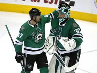 Dallas Stars right wing Alexander Radulov (47) and goaltender Ben Bishop (30) celebrate following an NHL hockey game against the New York Rangers Monday, Feb. 5, 2018, in Dallas. The Stars won 2-1. (AP Photo/Ron Jenkins)