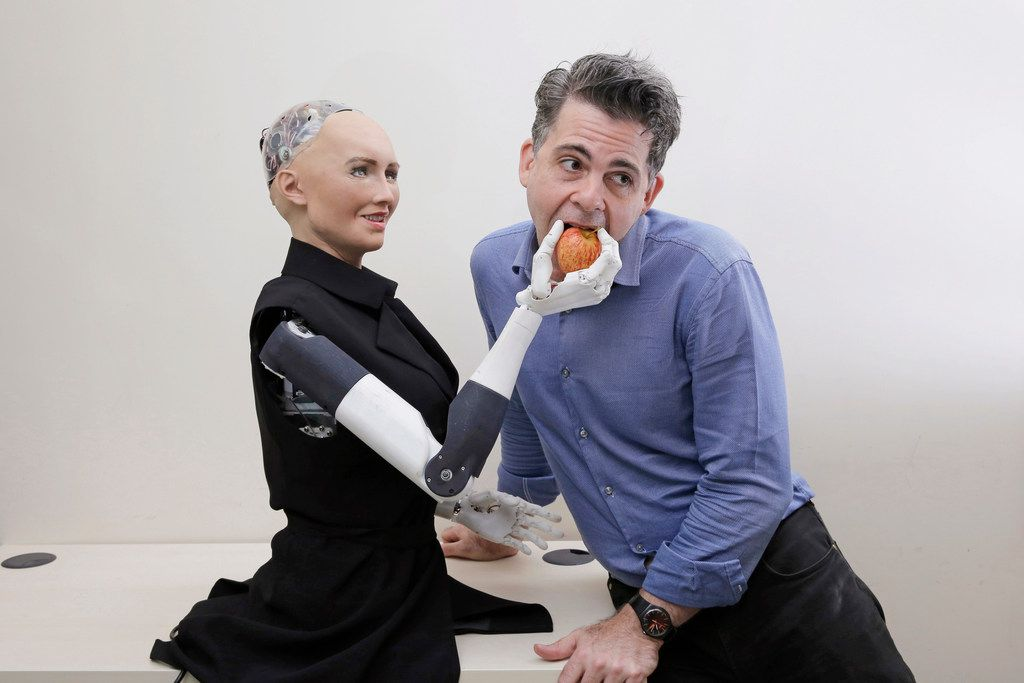 David Hanson, founder of Hanson Robotics, poses with his company's flagship robot Sophia.