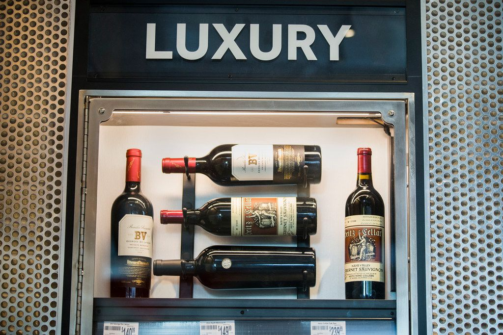 """""""Luxury"""" wines, including $239.99 bottles of cabernet sauvignon by Heitz Wine Cellars, are on sale at a new 7-Eleven """"lab store"""" in West Dallas."""