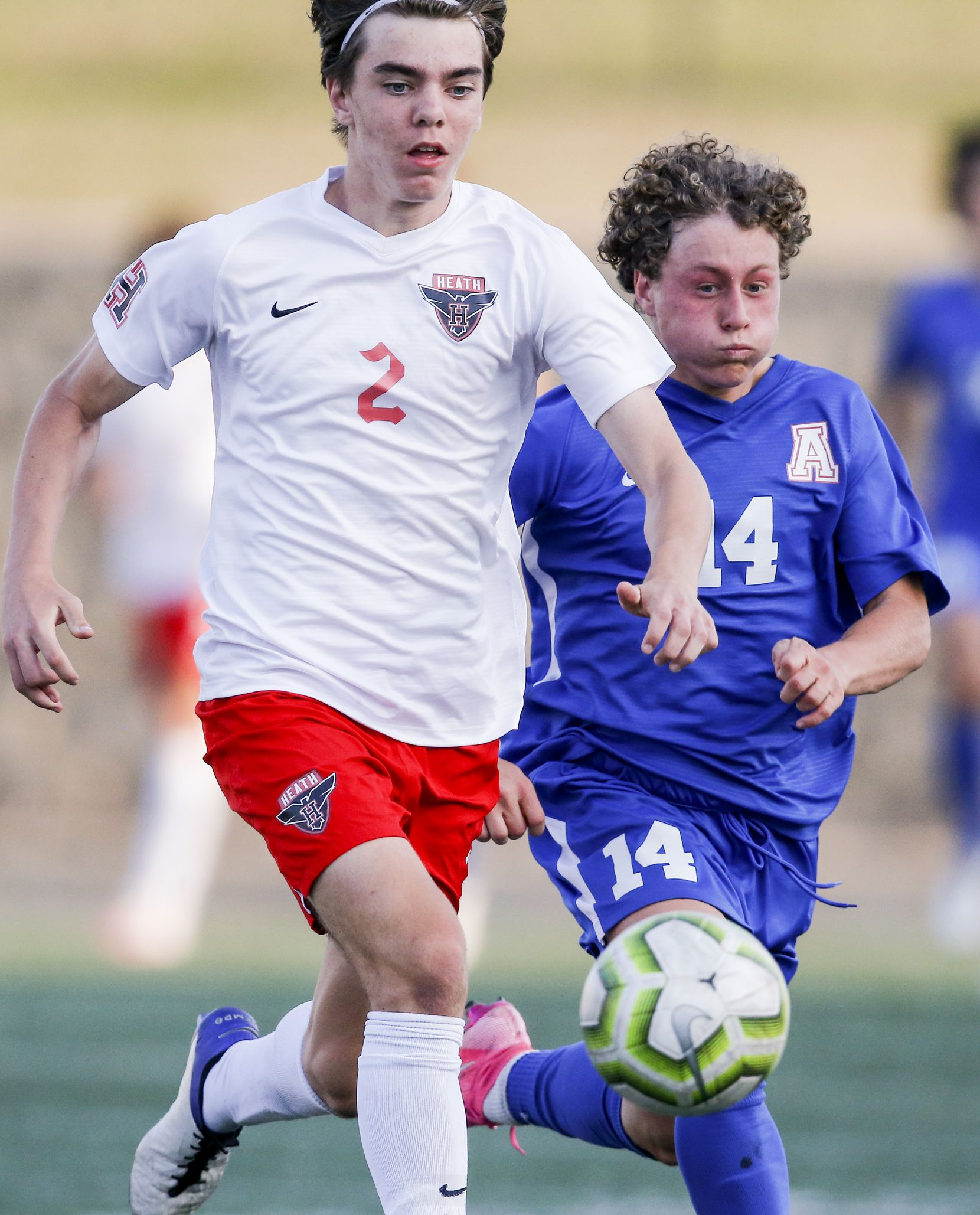 Rockwall-Heath sophomore defender Cole Dougherty (2) and Allen junior forward Matthew Sanchez (14) battle for the ball during the first half of a boys soccer Class 6A state semifinal at Mesquite Memorial Stadium in Mesquite, Tuesday, April 13, 2021. (Brandon Wade/Special Contributor)