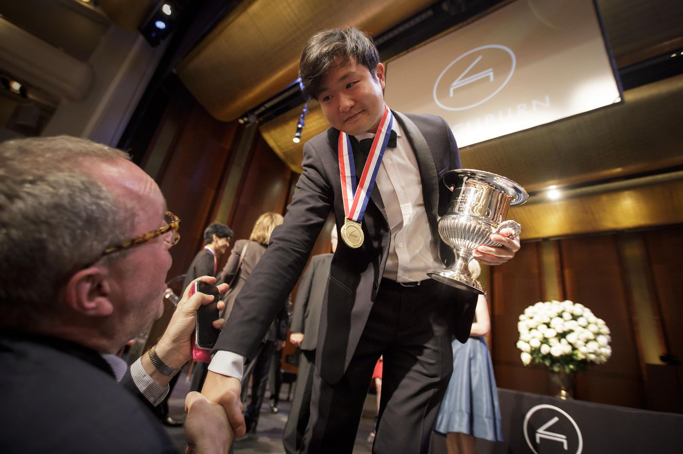 Gold medalist Yekwon Sunwoo of South Korea was congratulated after the Van Cliburn International Piano Competition awards ceremony at Bass Performance Hall in Fort Worth on Saturday. (Smiley N. Pool/Staff Photographer)