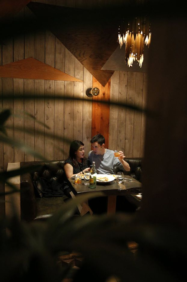 A couple dining in the bar at Madrina