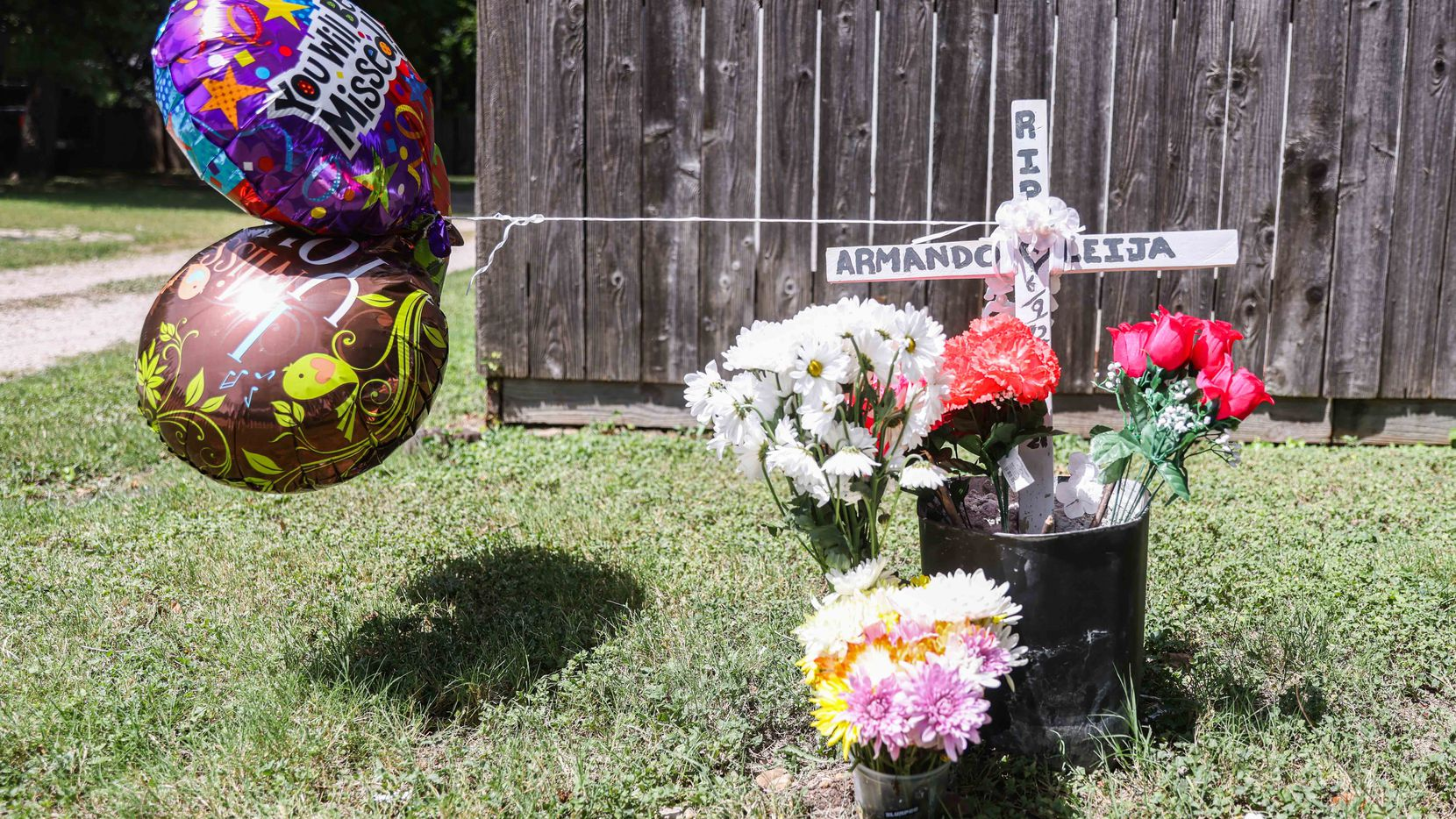 """Social media posts described Armando Leija Esparza as an amazing man who was devoted to his family and passionate about his work as """"the yard wizard"""" who took care of scores of landscaping customers. This makeshift memorial marked the site of the crash that resulted in his death July 19."""