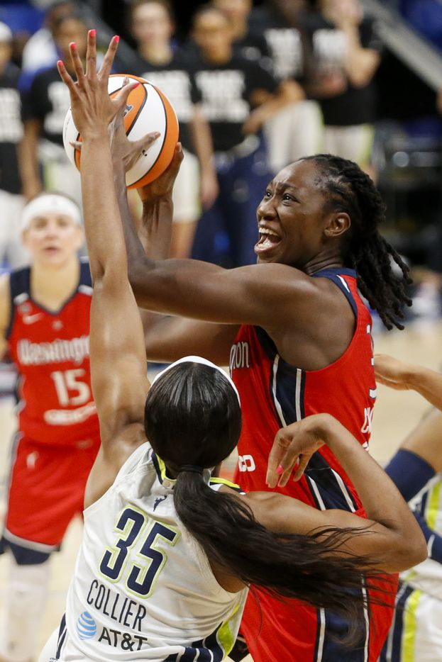Washington Mystics center Tina Charles (31) attempts a shot over Dallas Wings forward/center Charli Collier (35) during the first quarter at College Park Center on Saturday, June 26, 2021, in Arlington. (Elias Valverde II/The Dallas Morning News)