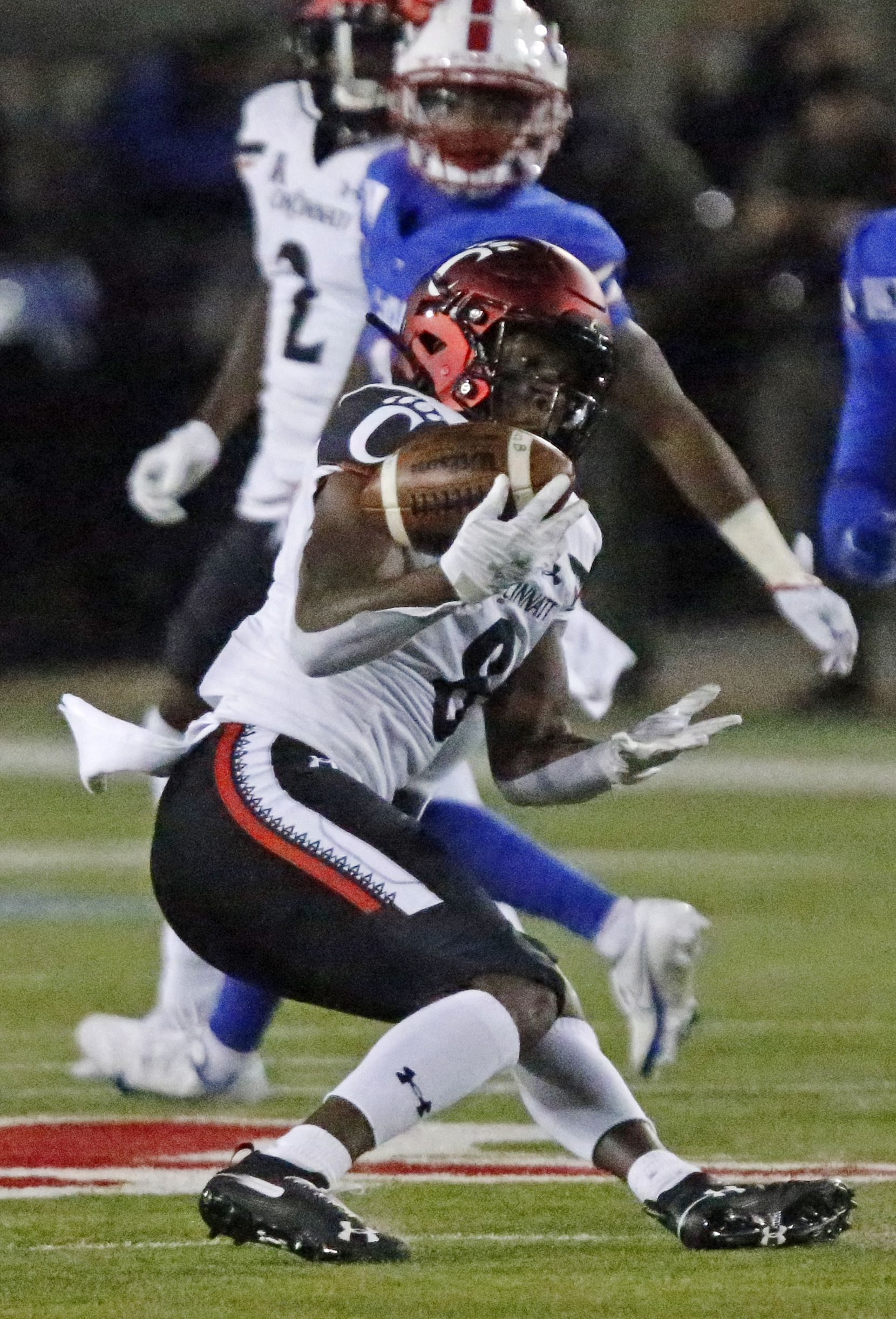 Cincinnati Bearcats wide receiver Michael Young Jr. (8) was unable to hang onto this pass during the first half as SMU hosted Cincinati University in an AAC football game at Ford Stadium in Dallas on Saturday night, October 24, 2020. (Stewart F. House/Special Contributor)