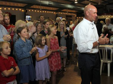 State Representative Jake Ellzey gives thumbs up to members of the media at the conclusion of an interview session as he is surrounded by supporters after being confirmed the winner of his runoff election with Susan Wright in the race to replace the late Ron Wright's seat in Congress. The election night party was held for Jake Ellzey at the Champions Club at the Texas Motorplex in Ennis on July 27, 2021. (Steve Hamm/ Special Contributor)