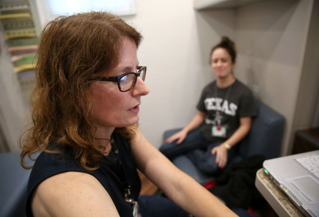 Dr. Lara Johnson, a family medicine physician, talks to patient Monica Frasier inside Parkland Memorial Hospital's mobile clinic, which is a part of its Homeless Outreach Medical Services program. (Rose Baca/The Dallas Morning News)