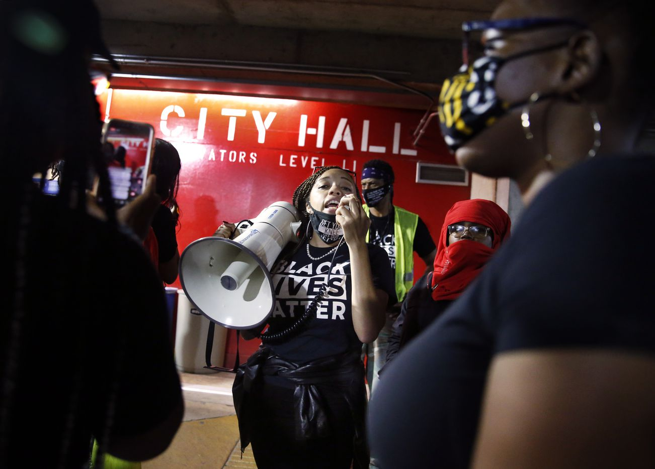 Next Generation Action Network led a parade of protestors down inside the City Hall parking garage where they tried to interrupt the Dallas City Council meeting. The small group was met by Dallas Police as they attempted to enter, Wednesday, September 23, 2020. They were there in support of Breonna Taylor who was killed by Louisville, Kentucky police.  A Kentucky grand jury brought no charges against the Louisville police for the killing of Taylor during a drug raid gone wrong. (Tom Fox/The Dallas Morning News)