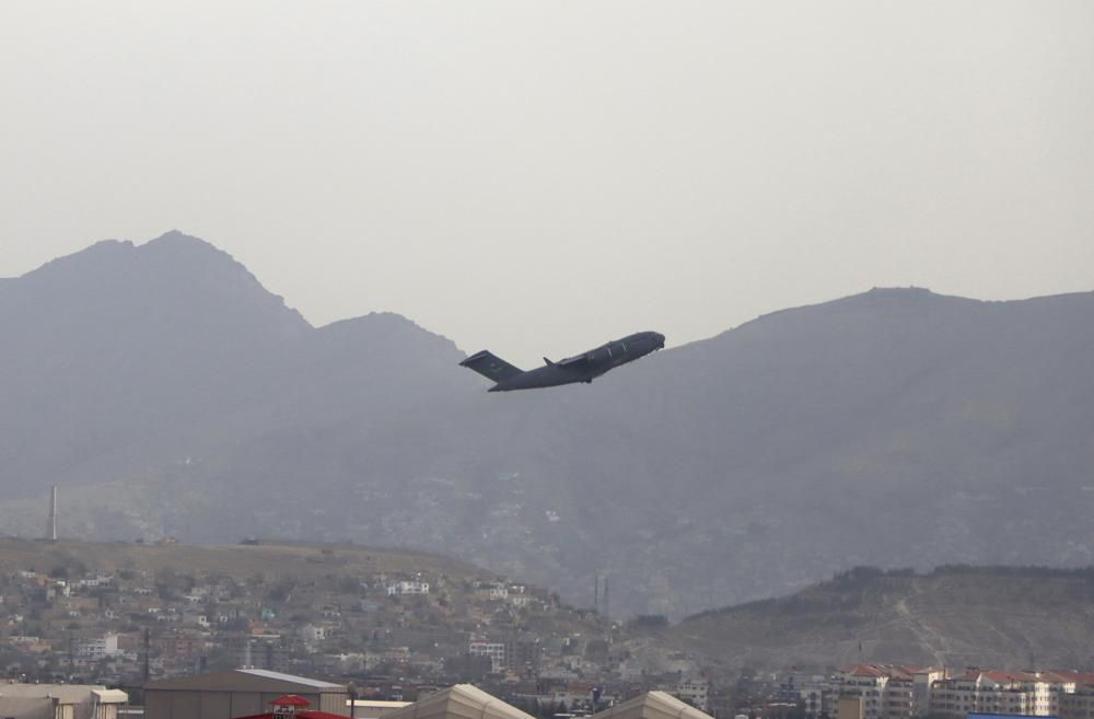 A U.S military aircraft takes off Monday from the Hamid Karzai International Airport in Kabul, Afghanistan.