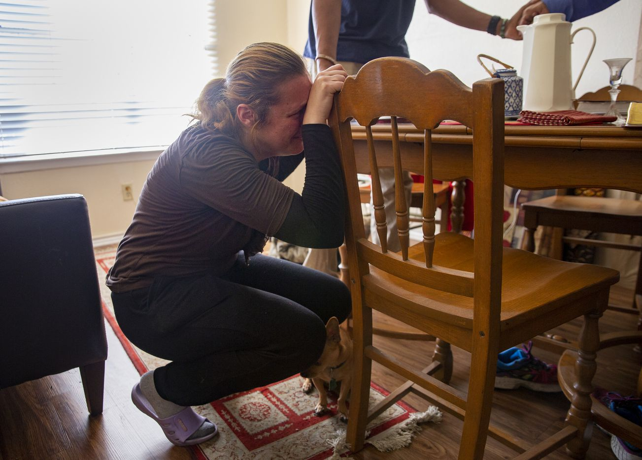 Cindy (last name withheld) breaks down as Jennifer and Leon Birdd pray over her and her home the first Sunday after the Birdds lost the S.O.U.L. Church lot in Dallas.