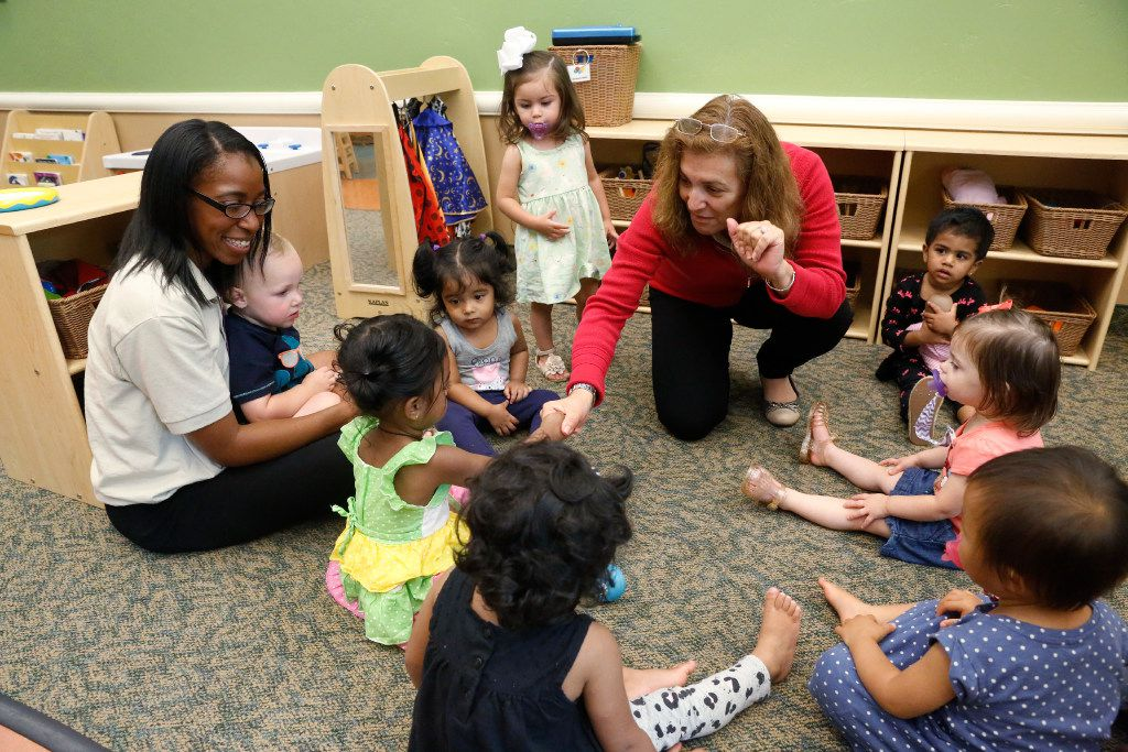 Teacher Anastasia Jenkins, left, and Spanish teacher Gladys Ocampo, right, work with ages 18-months to 23-months at the Children's Learning Adventure in McKinney on June 14. The company is expanding  with new campuses coming to Allen and Flower Mound.