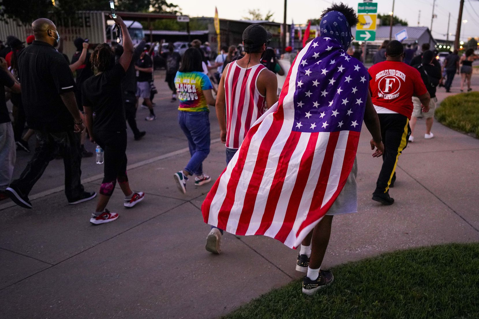 Protesters begin a march against police brutality as they depart a rally at the Dallas Police Headquarters on Friday, May 29, 2020, in Dallas.