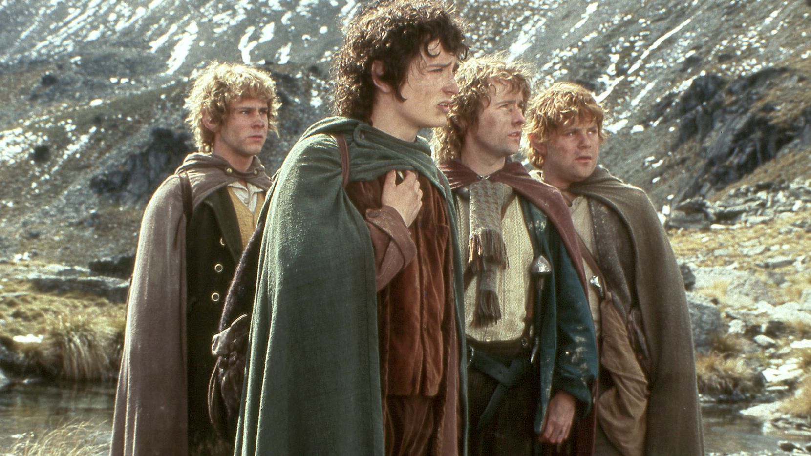 "This photo released by New Line Productions shows actors, from left, Dominic Monaghan as Merry, Elijah Wood as Frodo, Billy Boyd as Pippin and Sean Astin as Sam in a scene from New Line Cinema's ""The Lord of the Rings: Fellowship of the Ring."""