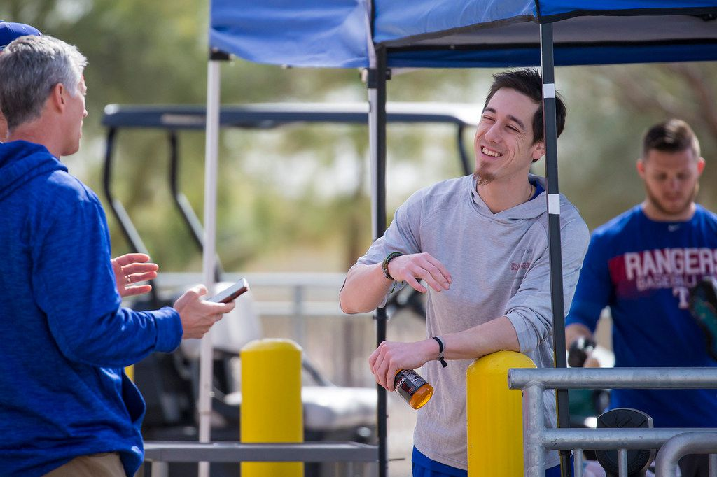 Pitcher Tim Lincecum talks with team staff after arriving at the Texas Rangers spring training facility on Tuesday, March 6, 2018, in Surprise, Ariz. (Smiley N. Pool/The Dallas Morning News)