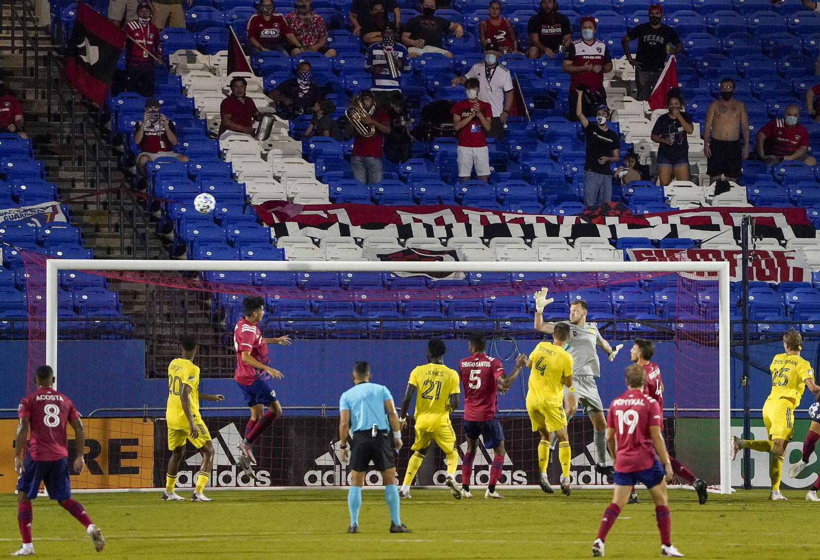 Socially distant FC Dallas supporters watch a corner kick sail over the head of forward Ricardo Pepi (16) in front of the Nashville SC goal during the second half of an MLS soccer game at Toyota Stadium on Wednesday, Aug. 12, 2020, in Frisco, Texas. (Smiley N. Pool/The Dallas Morning News)