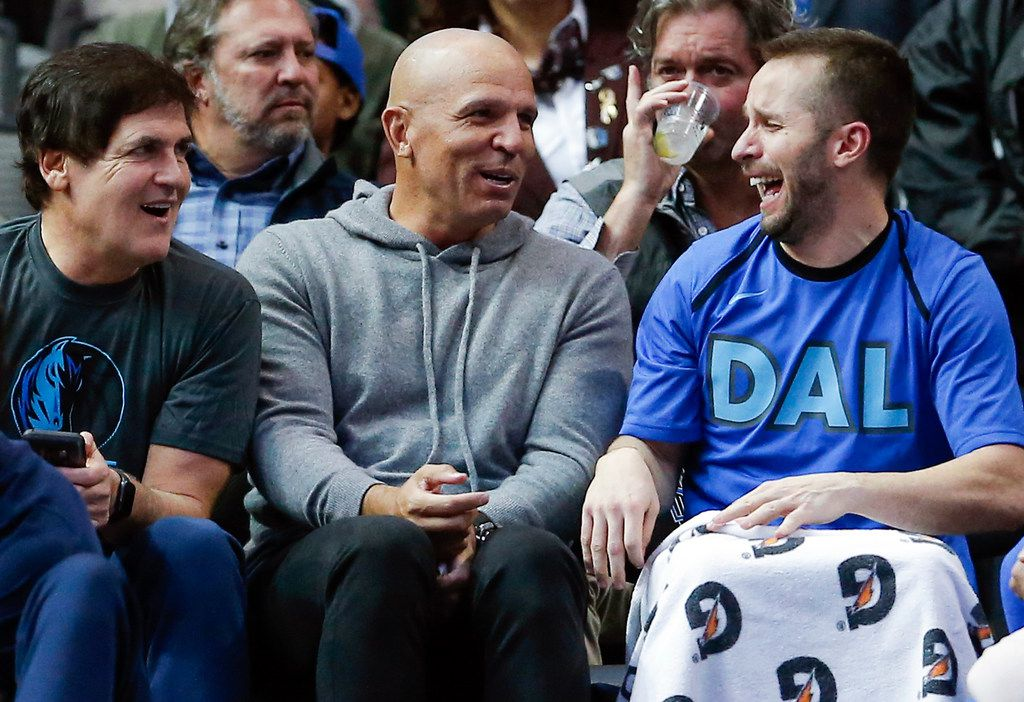 From left to right, Dallas Mavericks owner Mark Cuban, former player and coach Jason Kidd and guard J.J. Barea (5) sit in the stands during the second half of an NBA basketball game against the Orlando Magic, Monday, Dec. 10, 2018, in Dallas. (AP Photo/Brandon Wade)