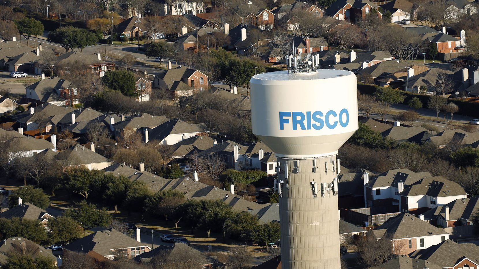 Frisco water tower and homes in Frisco, Texas on Friday, February 28, 2020.