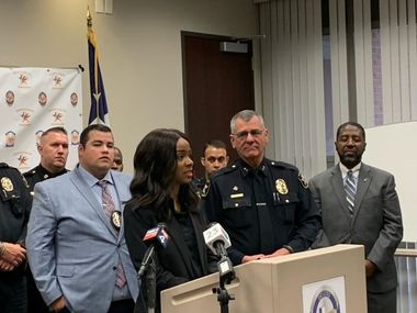Mayor Rachel Proctor speaks during a news conference in DeSoto, Texas, on Saturday, May 22, 2021, to announce the arrest of a shooting suspect with Police Chief Robert Costa (right), city council member Andre' Byrd (far right) and others.