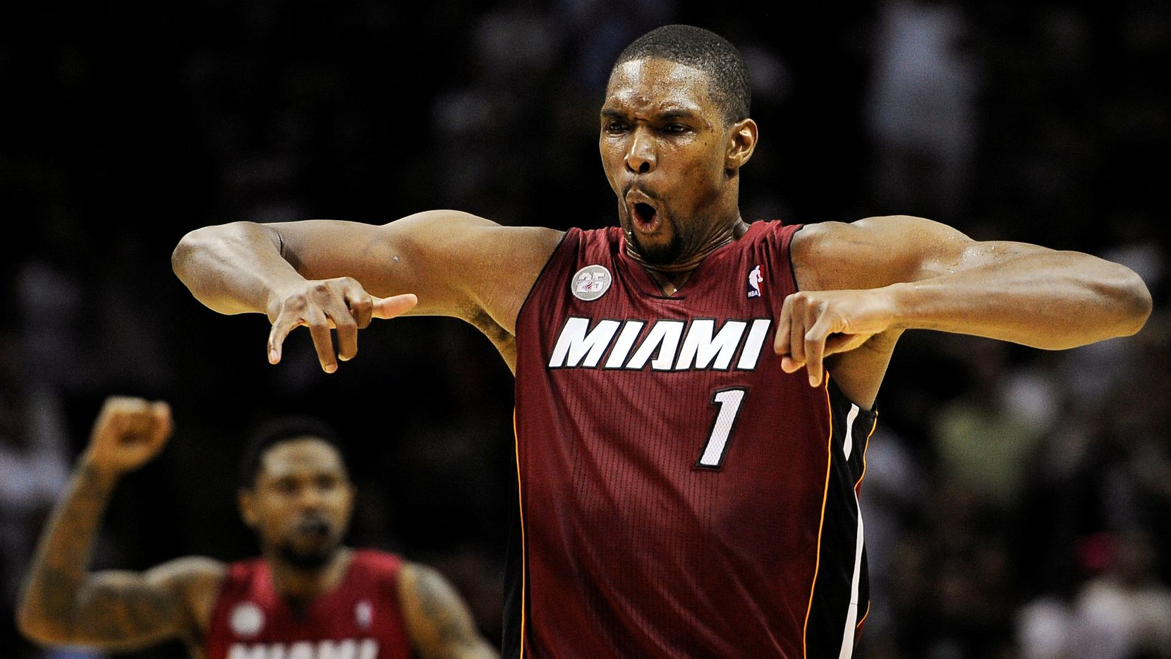 Miami Heat's Chris Bosh (1) yells after scoring the winning basket during the second half of an NBA basketball game against the San Antonio Spurs, Sunday, March 31, 2013, in San Antonio.