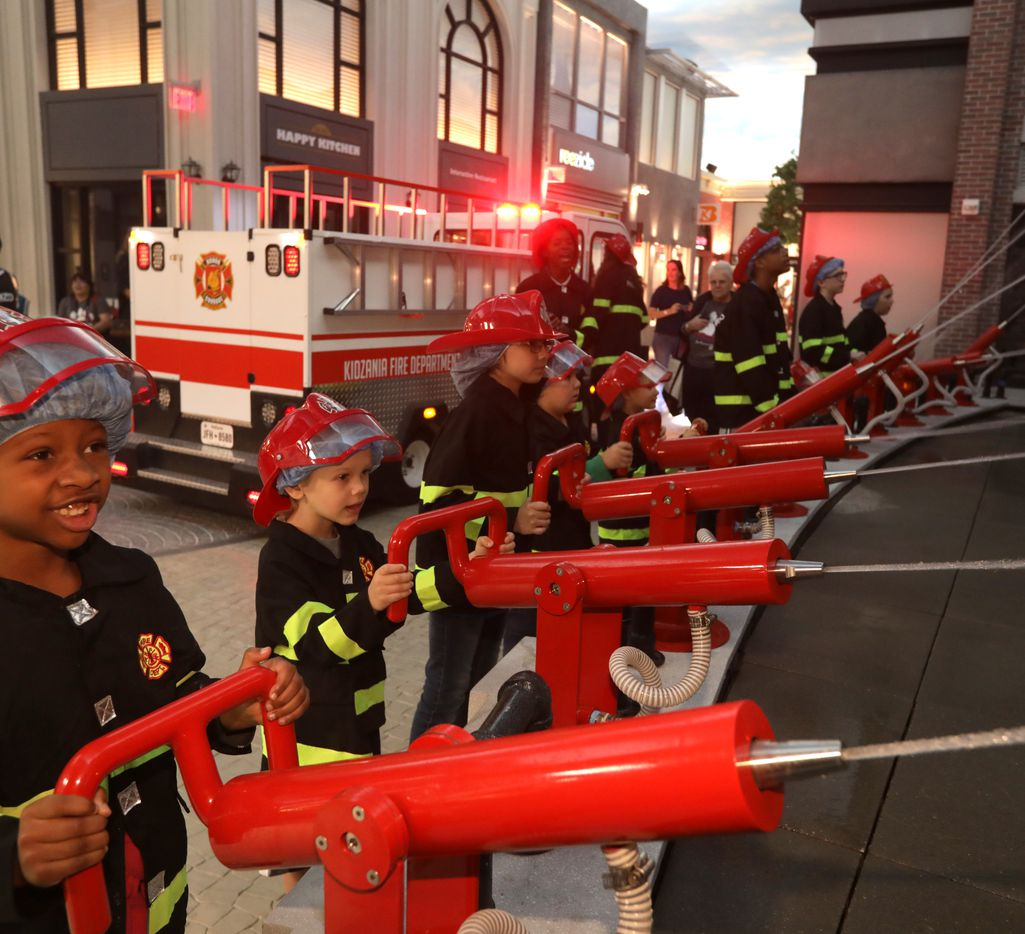 At KidZania in Stonebriar Centre, kids can experiment with professions such as firefighter.