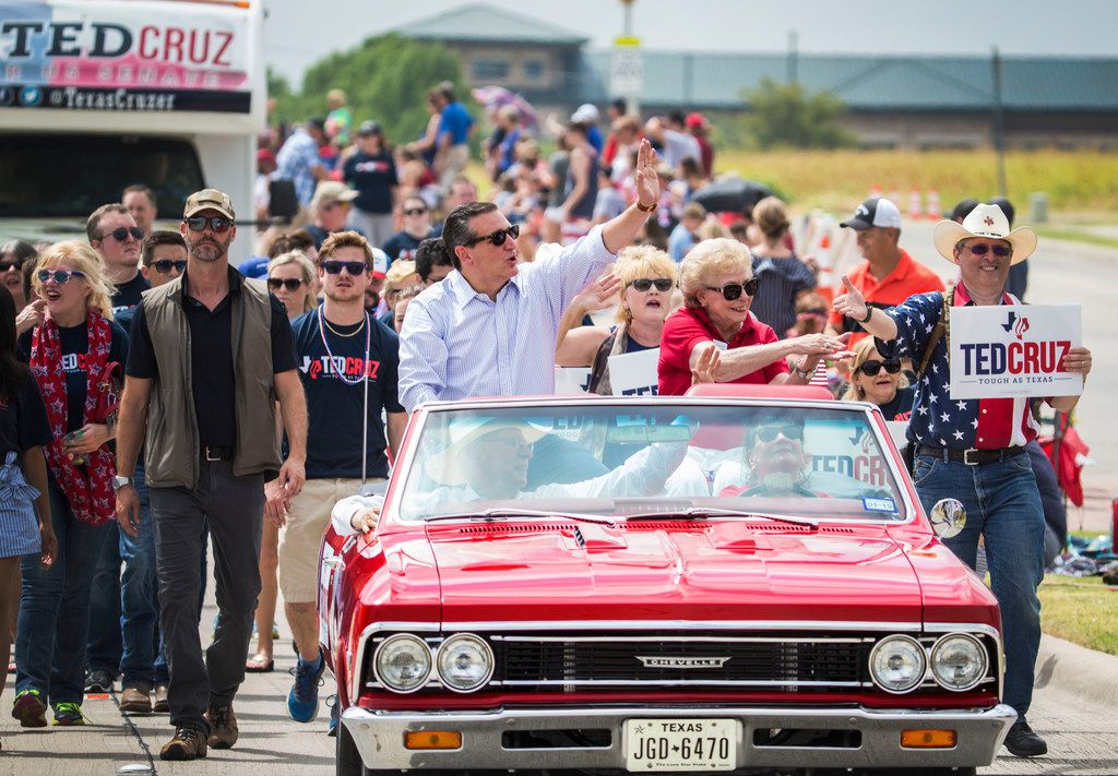 Texas Sen. Ted Cruz waves at the crowd during a Fourth of July parade in Rockwall on July 4, 2018. The city celebrated Independence Day with a parade and fireworks display.