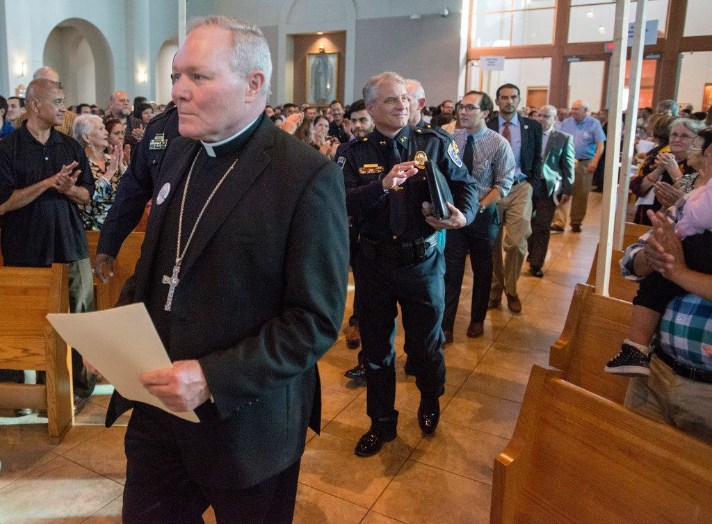 Catholic Diocese of Dallas Bishop Edward Burns led a procession of clergy, law enforcement officials and Dallas-area city officials to the dais at Mary Immaculate Catholic Church in Farmers Branch in November. Police officials from Dallas, Carrollton and Farmers Branch told the roughly 1,500 people that their officers had been given the discretion to accept church-issued ID cards as a form of identification. (File photo)