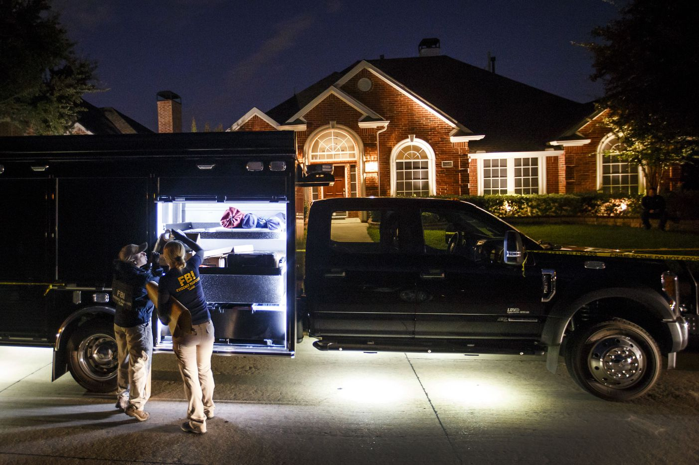 Members of an FBI evidence response team work at the family home of Sherin Mathews in the 900 block Sunningdale, on Tuesday, Oct. 10, 2017, in Richardson, Texas.  Authorities on Tuesday evening searched the Richardson home of a 3-year-old girl who has been missing since Saturday when her father reportedly sent her outside as punishment for not drinking her milk.(Smiley N. Pool/The Dallas Morning News)