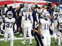 Cowboys quarterback Andy Dalton (14) walks to the sideline after throwing an interception in the fourth quarter against Washington at AT&T Stadium in Arlington on Thursday, Nov. 26, 2020.