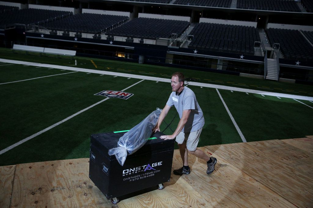 Harvest crew member Tim Blaney helps move equipment as crews setup for Harvest America at AT&T Stadium in Arlington, Texas Thursday June 7, 2018. Harvest America is Sunday night June 10, 2018. The Christian evangelistic outreach event includes top Christian music artists and a message form pastor Greg Laurie. (Andy Jacobsohn/The Dallas Morning News)