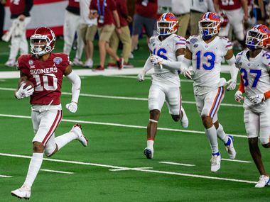 Oklahoma wide receiver Theo Wease (10) races past the Florida defense on 36-yard touchdown during the second quarter of the Goodyear Cotton Bowl Classic football game on Thursday, Dec. 30, 2020.