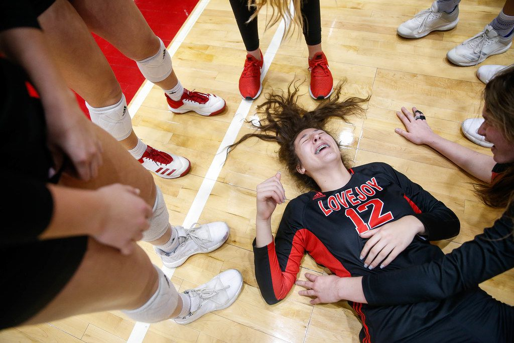 LovejoyÕs Hannah Gonzalez (12) falls to the floor after celebrating a class 5A volleyball state semifinal match win against Canyon Randall at the Curtis Culwell Center in Garland, on Saturday, November 23, 2019. Lovejoy won all three sets 27-25, 25-17 and 25-15. (Juan Figueroa/The Dallas Morning News)
