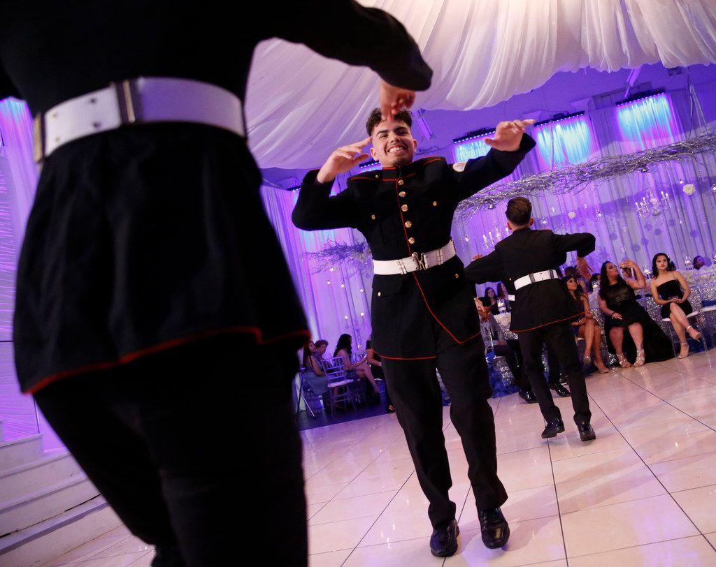 Edmundo Puente dances with the Latin Boyz Cadets during a quinceañera at the Latino Ballroom in Garland.