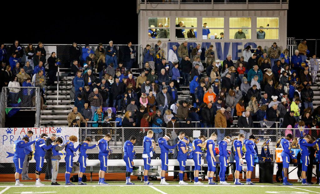 The Community High football team leans on one another during the playing of the national anthem at Community ISD Stadium in Nevada, Texas, Friday, November 8, 2019. They were playing with heavy hearts against Dallas Roosevelt after four of their classmates were killed in a tragic vehicle accident earlier this week. (Tom Fox/The Dallas Morning News)