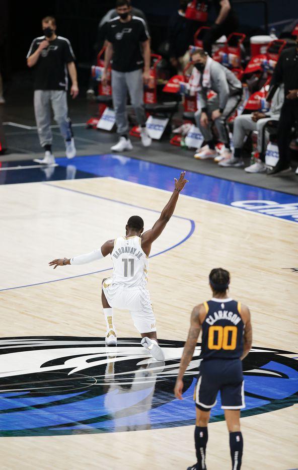 Utah Jazz guard Jordan Clarkson (00) looks on as Dallas Mavericks forward Tim Hardaway Jr. (11) celebrates a buzzer beater three-point shot at the end of the third quarter during an NBA basketball game in Dallas, Monday, April 5, 2021. (Brandon Wade/Special Contributor)