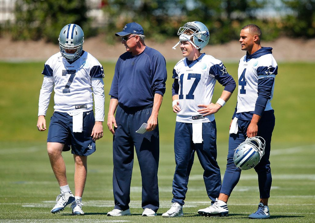 Dallas Cowboys quarterbacks coach Wade Wilson (second from left) is pictured with his players from left, rookie Cooper Rush (7), Kellen Moore (17) and Dak Prescott (4) during organized team activities at The Star in Frisco, Texas, Wednesday, May 24, 2017. (Tom Fox/The Dallas Morning News)