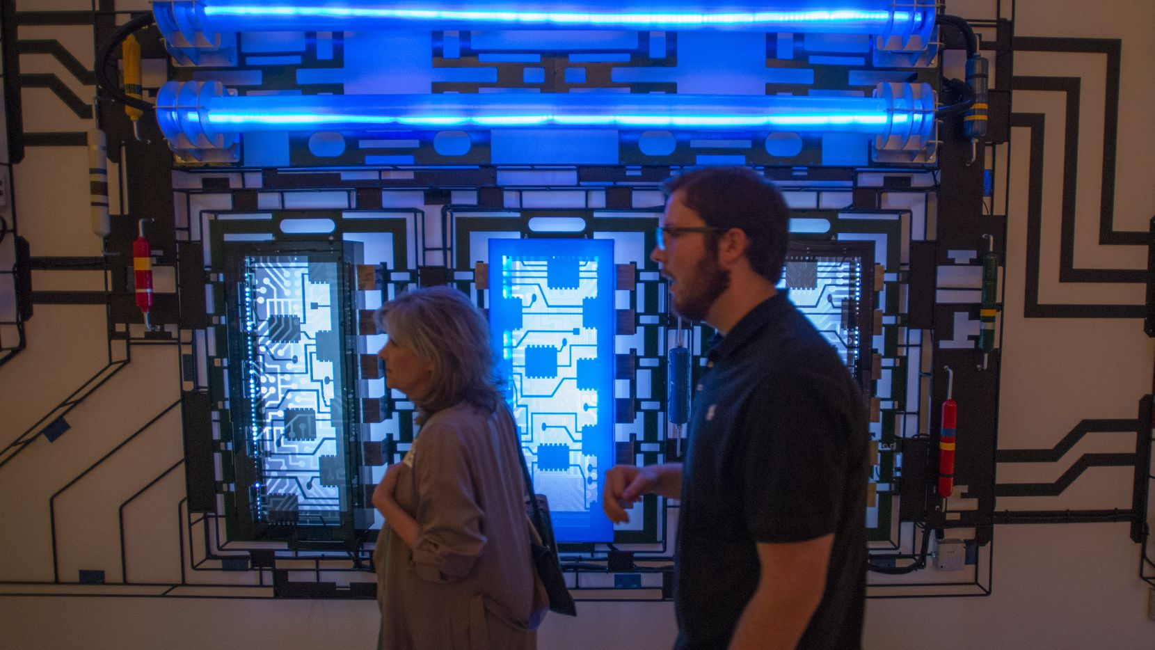"Guests stroll past a portion of the triptych art installation ""Motherboard"" in the Green Mezzanine Gallery at the Eisemann Center during the unveiling and reception on March 6, 2020 in Richardson, Texas."