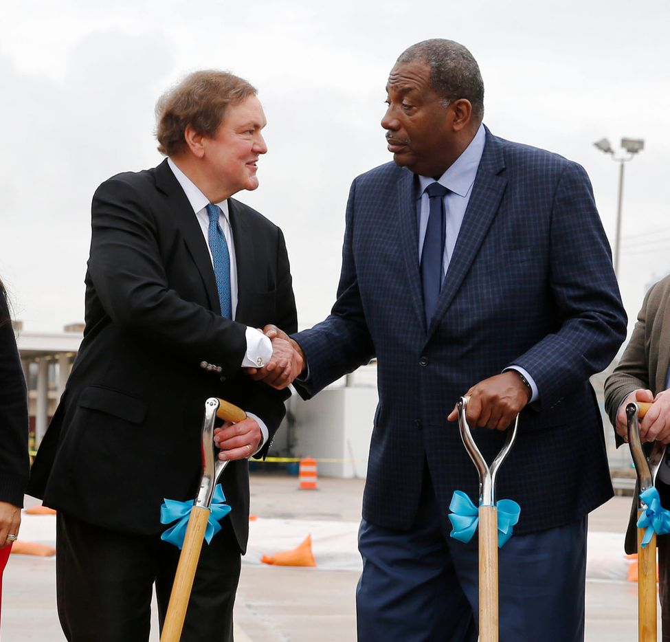 J. Bruce Bugg Jr., Texas transportation commission chairman, and State Sen. Royce West, D-Dallas, shake hands during a groundbreaking ceremony of The Southern Gateway Project in Dallas on Wednesday.  Part of the project includes infrastructure for another deck park, similar to Klyde Warren Park over Woodall Rodgers Freeway.