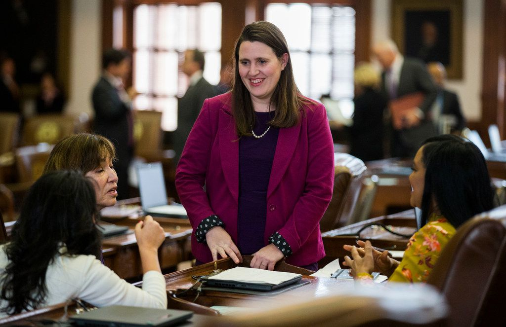 Rep. Erin Zwiener, D-Driftwood, talks with other representatives on the third day of the 86th Texas legislature on Thursday. Zwiener, who is bisexual, is a member of the state Legislature's first ever LGBTQ caucus.
