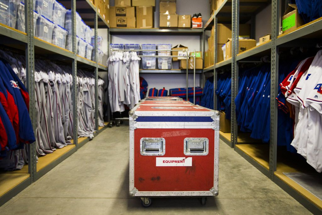 Equipment like jerseys, pants, socks and batting gloves fill shelves in the equipment room at Texas Rangers newly renovated spring training facility during a media tour on Thursday, Feb. 18, 2016, in Surprise, Ariz. (Smiley N. Pool/The Dallas Morning News)