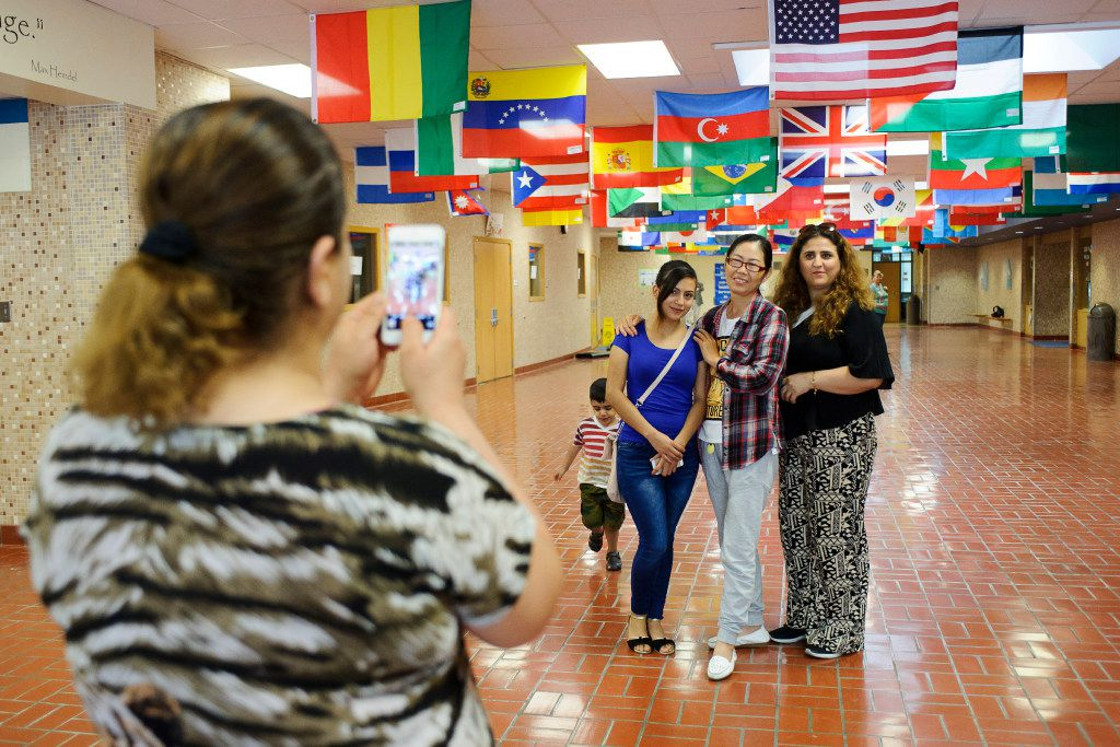 Students from Iraq, Mexico and China took pictures together after the last class of a Lincoln Literacy summer session at Culler Middle School in Lincoln, Neb., on Wednesday, July 12, 2017. Lincoln Literacy is a nonprofit formed to teach the English language to immigrants and refugees arriving in the city. (Matt Ryerson/Special Contributor)