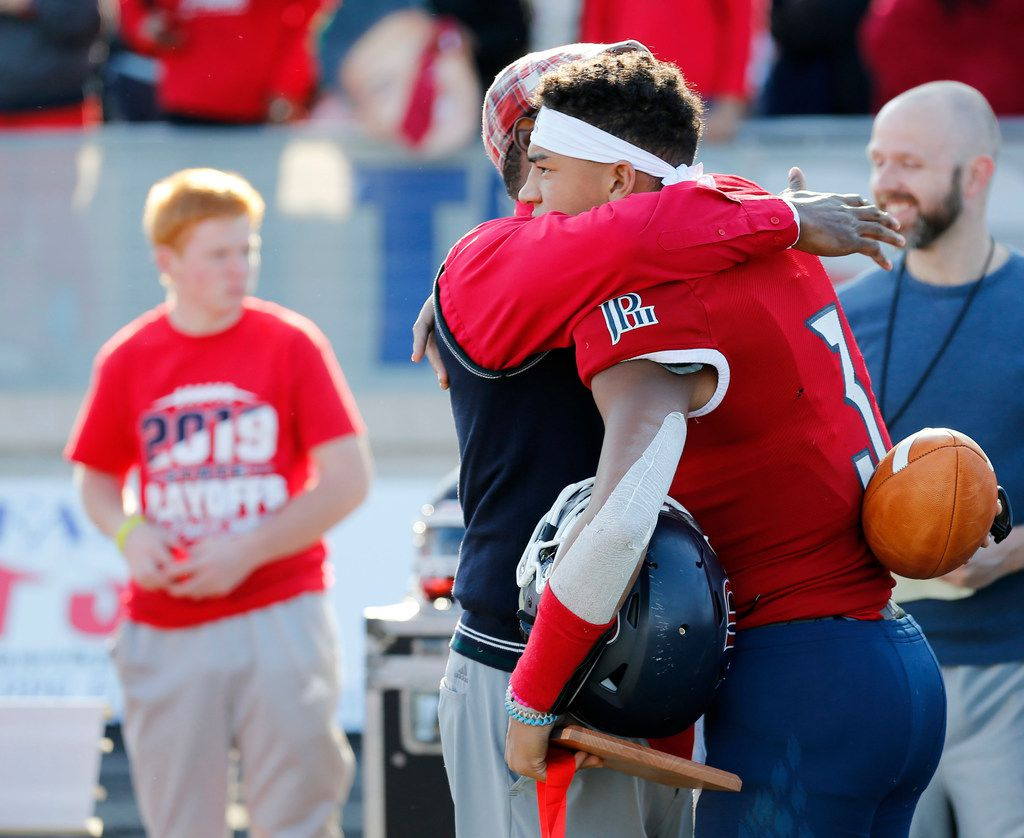 Plano John Paul II's head coach George Teague hugs Grayson James (3) after losing to Parish Episcopal 42-14 in the TAPPS Division I State Championship game at Waco Midway's Panther Stadium in Hewitt, Texas on Friday, December 6, 2019. (Vernon Bryant/The Dallas Morning News)