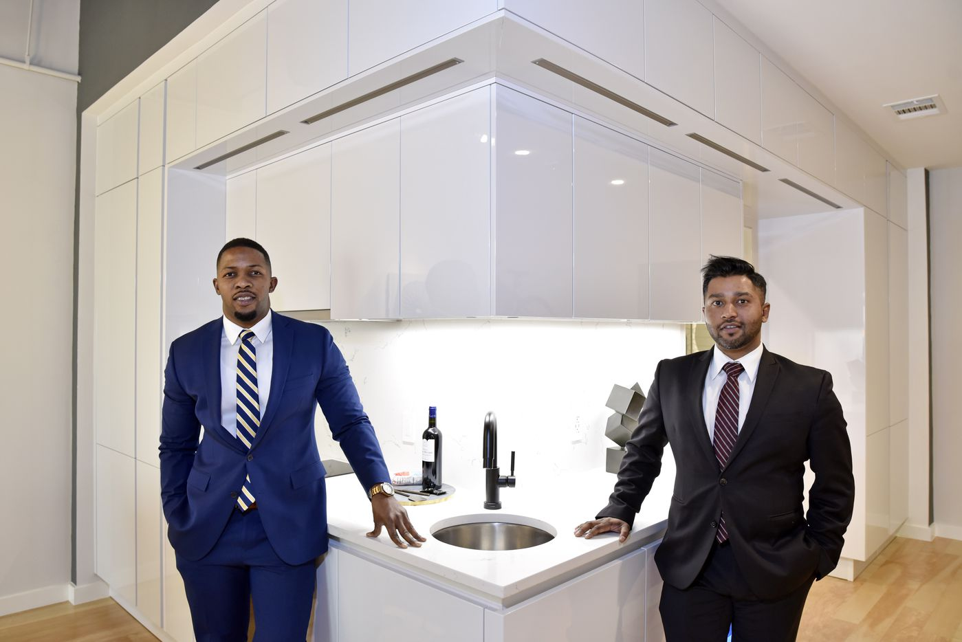 Developers Ike Bams (left) and John Williams of Bluelofts shown with an assembled kitchen area in downtown Dallas.