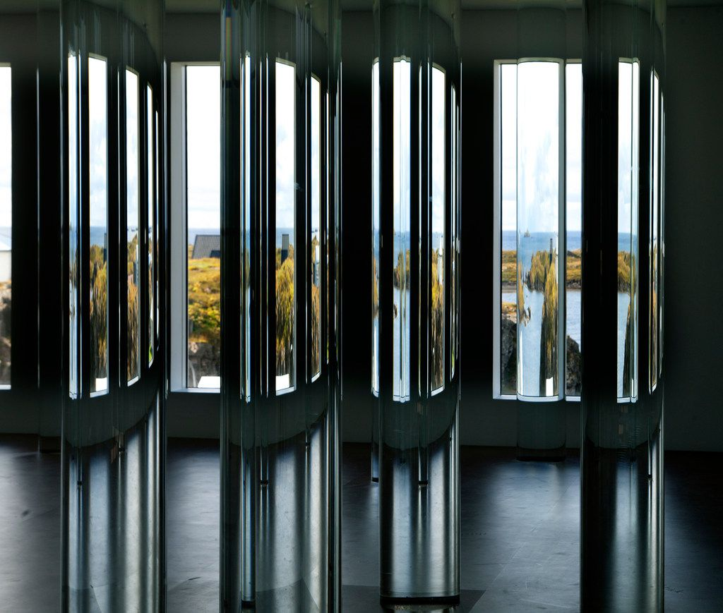 Interior installation detail of glass cylinders holding water from ice of Iceland's major glaciers at artist Roni Horn's Library of Water in Stykkishólmur, Iceland