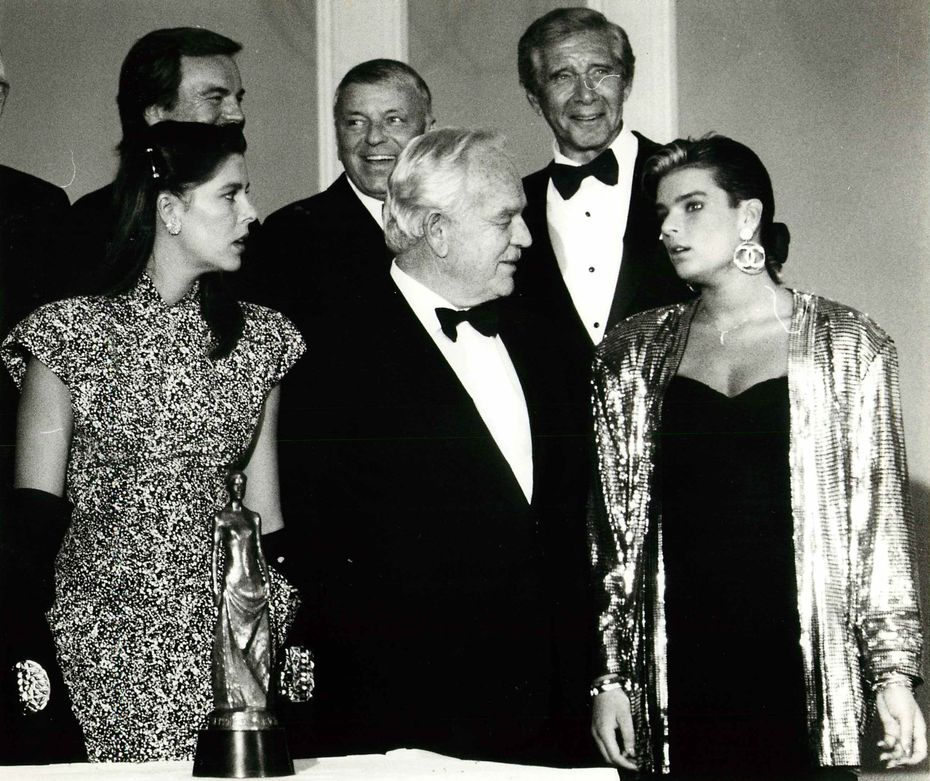 Shot October 18, 1986: Prince Rainier and his three children, Prince Albert and Princesses Stephanie and Caroline, were in Dallas for the Princess Grace Foundation-U.S.A. awards gala. The nonprofit foundation was formed in 1983 to help fund the careers of young performing artists in America.  Shown here are (front row, from left) Princess Caroline, Prince Rainier and Princess Stephanie; (back row, from left) Robert Wagner, Frank Sinatra and Jan Murray.