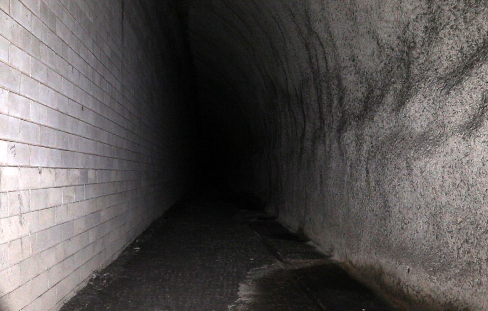 Groundwater seeps into a dark corner of DART's unfinished Knox Street rail station 80 feet below Central Expresway.
