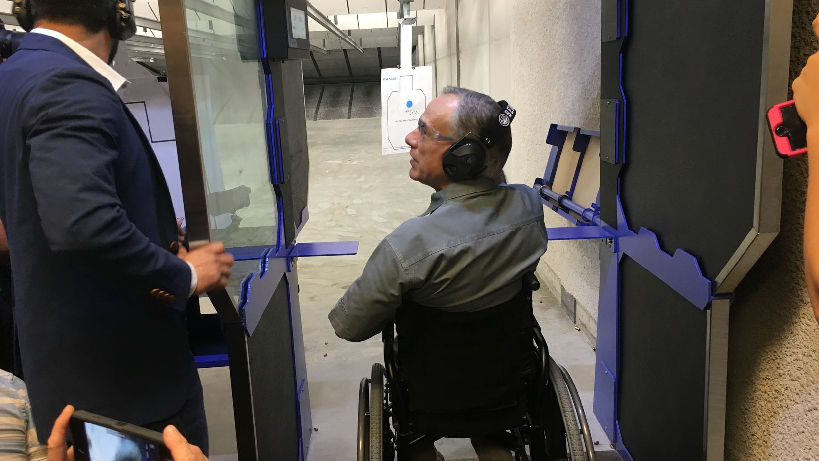 Gov. Greg Abbott at The Range in Austin on Friday, after signing a bill to lower the cost of a license to carry.