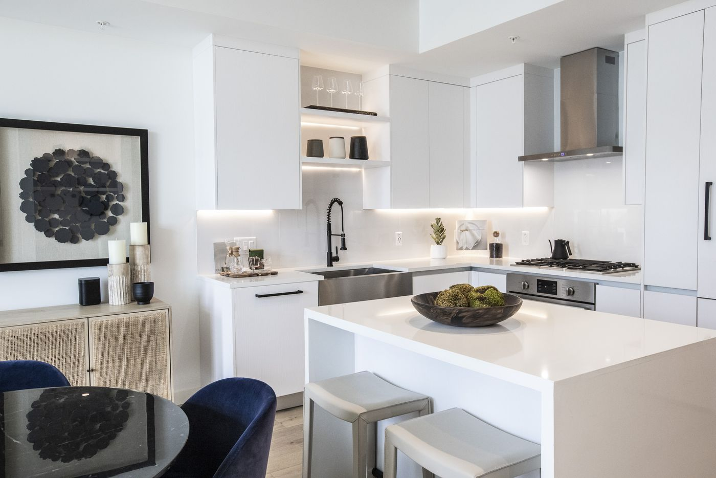 The kitchen and dining room area of a one-bedroom unit at the Atelier, a 41-story luxury residential building in the heart of the Dallas Arts District. (Lynda M. González/The Dallas Morning News)