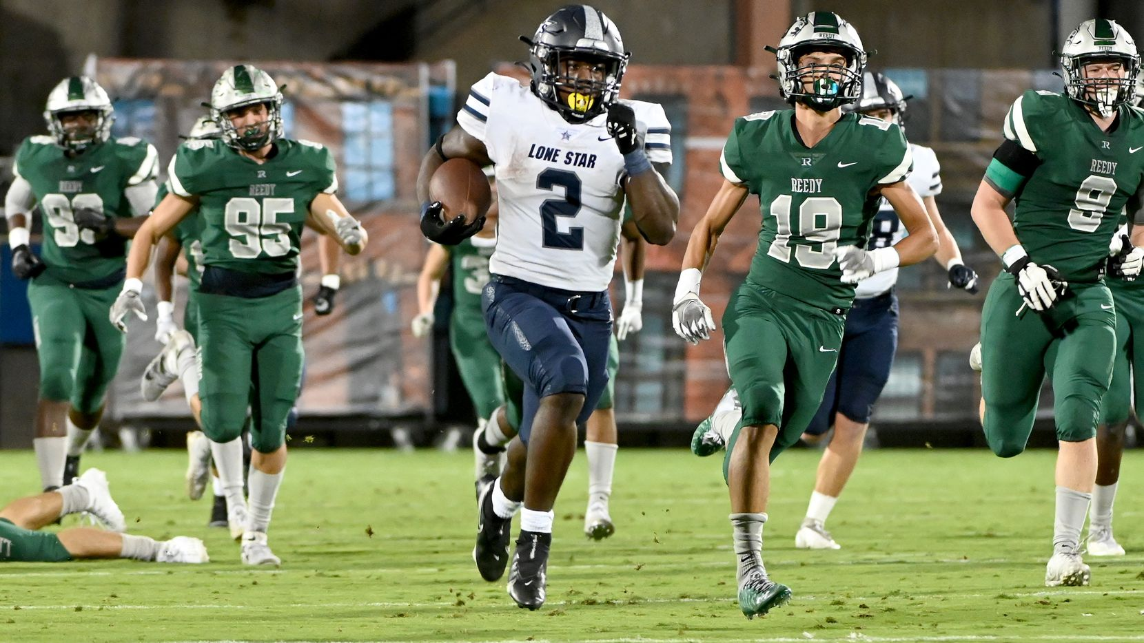 Frisco Lone Star's Ashton Jeanty (2) runs for a long touchdown in the first half of a high school football game between Frisco Reedy and Frisco Lone Star, Friday, Sept. 30, 2021, in Frisco, Texas.