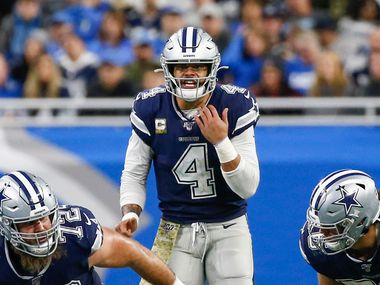 FILE - Cowboys quarterback Dak Prescott (4) calls a play during the second half of a matchup against the Lions at Ford Field in Detroit on Sunday, Nov. 17, 2019.