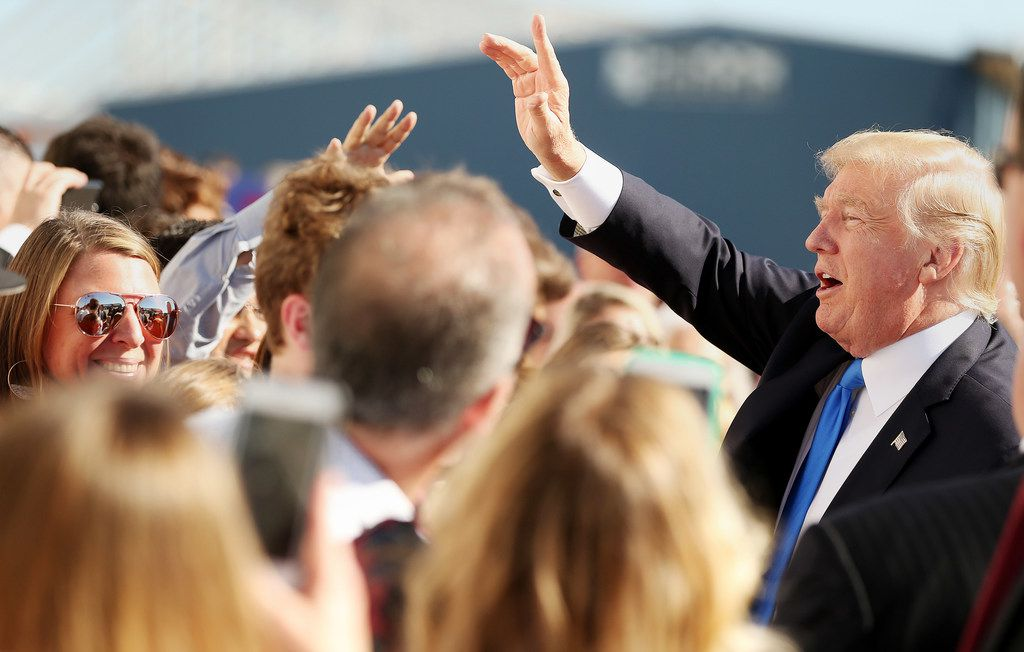 President Donald Trump greets supporters after arriving at Love Field in Dallas Wednesday October 25, 2017. President Trump will participate in a hurricane recovery briefing, a Republican National Committee roundtable and give remarks at a reception.